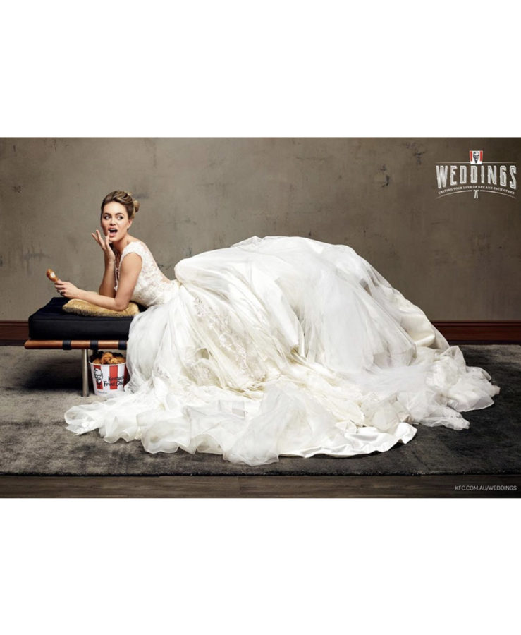 Photo of model posing as a bride and eating KFC